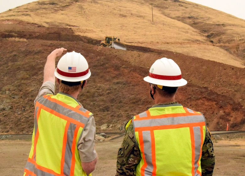 USACE Sacramento District Commander COL James Handura (right) gets a construction update as groundbreaking gets underway on the Tule River Spillway Enlargement Project at Success Lake near Porterville, California.