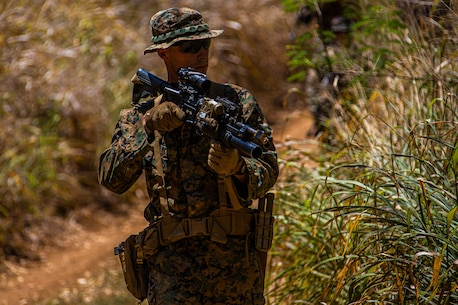 A U.S. Marine with Company F, 2nd Battalion, 3rd Marine Regiment, observes his surroundings while executing improvised explosive device training during Exercise Bougainville I at Marine Corps Training Area Bellows, Hawaii, Aug. 26, 2020. Bougainville I is designed to train and evaluate team leaders in small unit proficiency and increase the Battalion's combat readiness. (U.S. Marine Corps photo by Cpl. Jacob Wilson)
