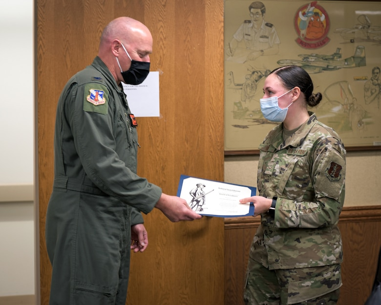 Airman receiving award.