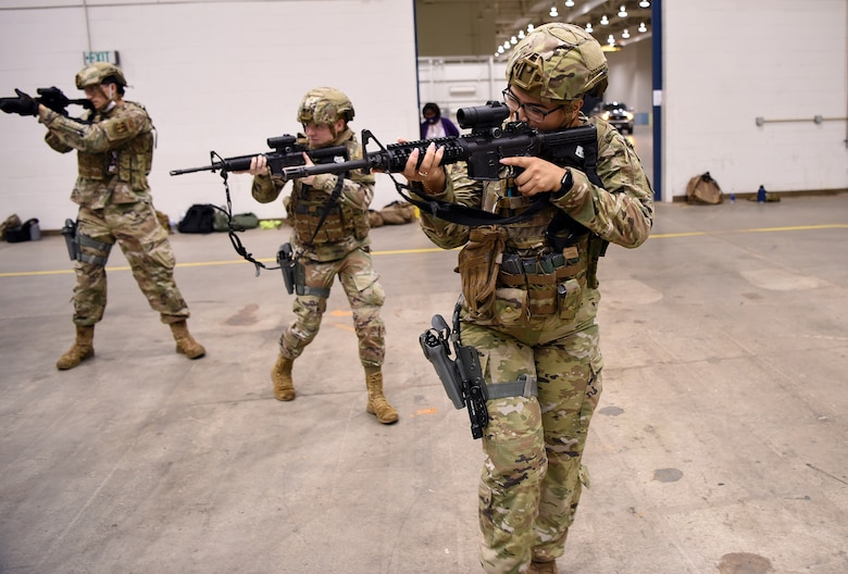 Photo of Airmen with weapons