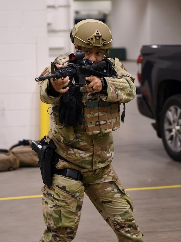 Photo of Airman with weapon