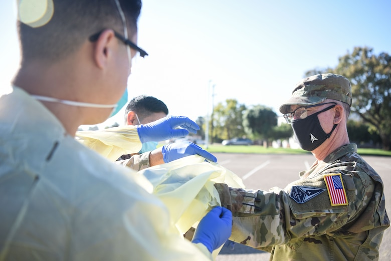 Chief Master Sgt. Roger A. Towberman, U.S. Space Force senior enlisted advisor, is shown how COVID-19 test are performed at the 30th Medical Group Sept. 24, 2020, at Vandenberg Air Force Base, Calif. Airmen from across the 30th MDG briefed Towberman on the innovative medical capabilities the unit has used to support U.S. Air Force and U.S. Space Force professionals across the installation. The Airmen demonstrated their current COVID-19 testing capabilities, in addition to their air quality assessments, which are used as a precaution due to the California wildfires that have elevated the base's Air Quality Index. (U.S. Space Force photo by Senior Airman Hanah Abercrombie)