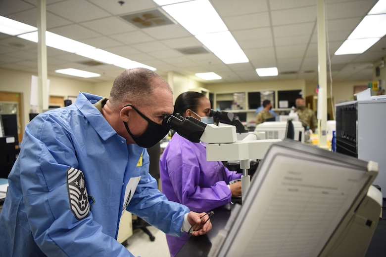 Chief Master Sgt. Roger A. Towberman, U.S. Space Force senior enlisted advisor, visits the 30th Medical Group Sept. 24, 2020, at Vandenberg Air Force Base, Calif. Airmen from across the 30th MDG briefed Towberman on the innovative medical capabilities the unit has used to support U.S. Air Force and U.S. Space Force professionals across the installation. The Airmen demonstrated their current COVID-19 testing capabilities, in addition to their air quality assessments, which areused as a precaution due to the California wildfires that have elevated the base's Air Quality Index. (U.S. Space Force photo by Senior Airman Hanah Abercrombie)