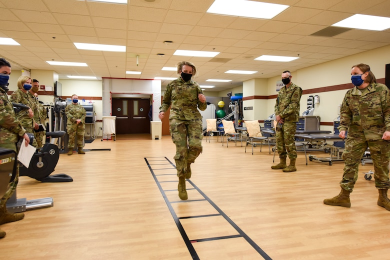 U.S. Air Force Col. Kirsten Aguilar, Joint Base Elmendorf-Richardson and 673d Air Base Wing commander, participates in a gate exercise in the physical therapy clinic during a 673d Medical Operations Squadron immersion tour at JBER, Alaska, Sept. 24, 2020. Aguilar familiarized herself with the 673d MDOS and its role in supporting installation readiness after taking command of the installation on July 14, 2020. The 673d MDOS works to enhance the performance and overall health of JBER in order to ensure combat effectiveness. (U.S. Air Force photo by Senior Airman Crystal A. Jenkins)