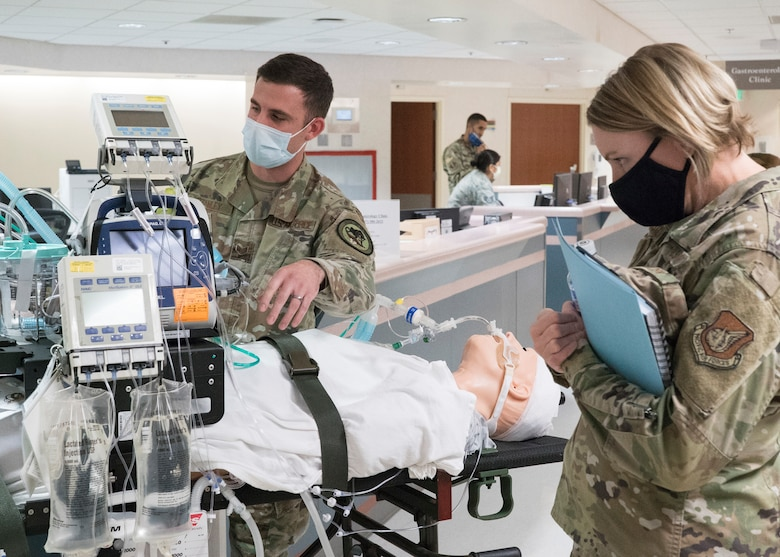 U.S. Air Force Staff Sgt. David Stanley Jr., 673d Medical Operations Squadron noncommissioned officer in charge of cardiology services, demonstrates to U.S. Air Force Col. Kirsten Aguilar, Joint Base Elmendorf-Richardson and 673d Air Base Wing commander, capabilities of a Critical Care Air Transport Team during a 673d MDOS immersion tour at JBER, Alaska, Sept. 24, 2020. Aguilar familiarized herself with the 673d MDOS and its role in supporting installation readiness after taking command of the installation on July 14, 2020. The 673d MDOS works to enhance the performance and overall health of JBER in order to ensure combat effectiveness. (U.S. Air Force photo by Senior Airman Crystal A. Jenkins)