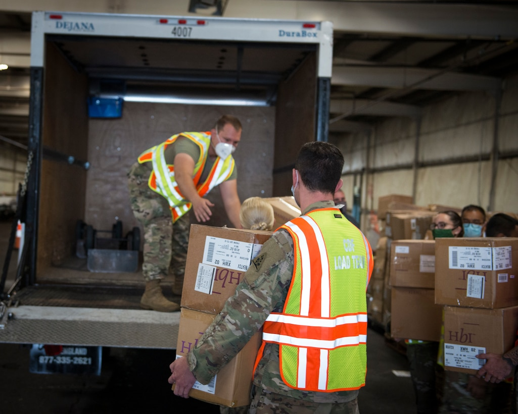 Soldiers and Airmen from the Connecticut National Guard load boxes of face masks into a vehicle at West Hartford Public Works, West Hartford, Connecticut, Sept. 30, 2020. The Connecticut National Guard is helping distribute 600,000 masks to school districts throughout the state.