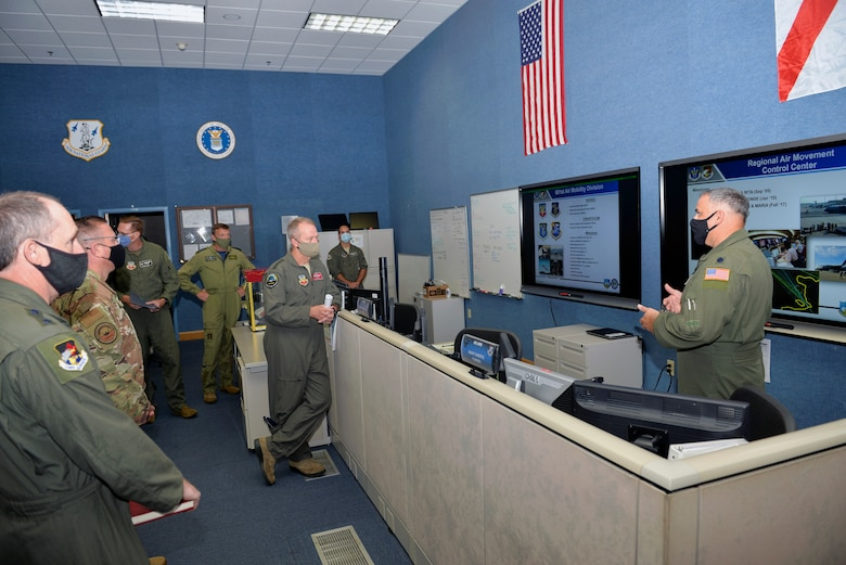 U.S. Air Force Lt. Col. Lewis Hagler, 601st Air Operations Center Air Mobility Division, briefs U.S. Air Force Gen. Mark Kelly, commander of Air Combat Command, on the AOC's air mobility operations during a visit to Tyndall Air Force Base, Florida, Sept. 29, 2020.