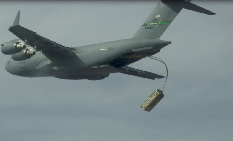 A high altitude airdrop of palletized munitions (JASSM simulants) from a C-17 using standard operational airdrop procedures was conducted during the Air Force's Advanced Battle Management Family of Systems (ABMS) Onramp #2 activities. (Courtesy photo)