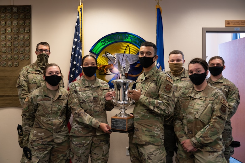 The 790th Missile Security Forces Squadron Airmen pose for photos with the Cheyenne Trophy on F.E. Warren Air Force Base, Wyoming, Sept. 10, 2020. The Greater Cheyenne Chamber of Commerce recently presented the Military Affairs Committee's Cheyenne Trophy to the 790th Missile Security Force Squadron for mission accomplishments, patriotism, off-duty volunteerism and community involvement resulting in a positive impact on the city of Cheyenne and its residents. (U.S. Air Force photos by Joseph Coslett)