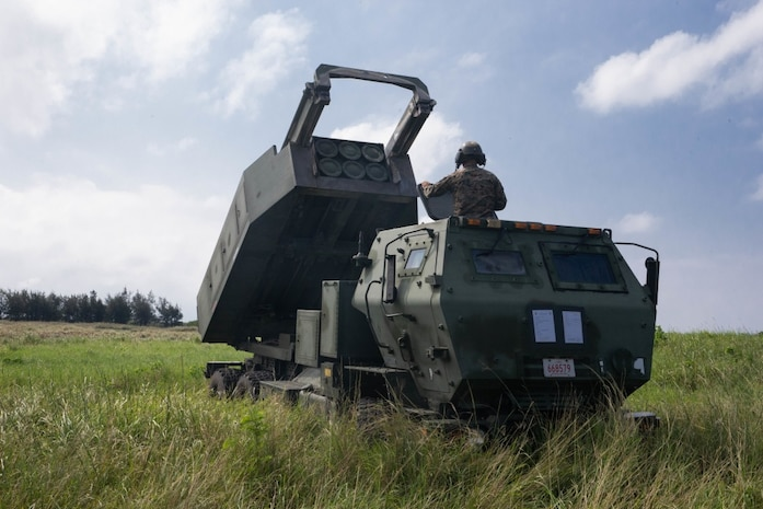 U.S. Marines with 12th Marine Regiment, 3d Marine Division, conduct a fire mission during a High Mobility Artillery Rocket System rapid infiltration exercise at Ie Shima, Japan, Sept. 24, 2020. The exercise represented a step forward in demonstrating how III Marine Expeditionary Force units can leverage the unique capabilities of joint partners in rapidly dispersing to and operating from key maritime terrain, sustain distributed positions, and quickly displace or withdraw as necessitated by the tactical situation. (U.S. Marine Corps photo by Cpl. Donovan Massieperez)