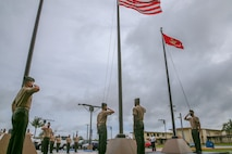 U.S. Marines and personnel assigned to Marine Corps Base (MCB) Camp Blaz observe the first flag raising of the new command, marking the initial operation capability of the base in Dededo, Guam, Oct. 1, 2020. MCB Camp Blaz is the first new Marine Corps base activated since March 1, 1952 and will hold an activation ceremony in the spring of 2021.