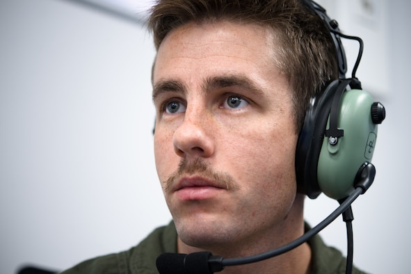Photo of Airman wearing headset