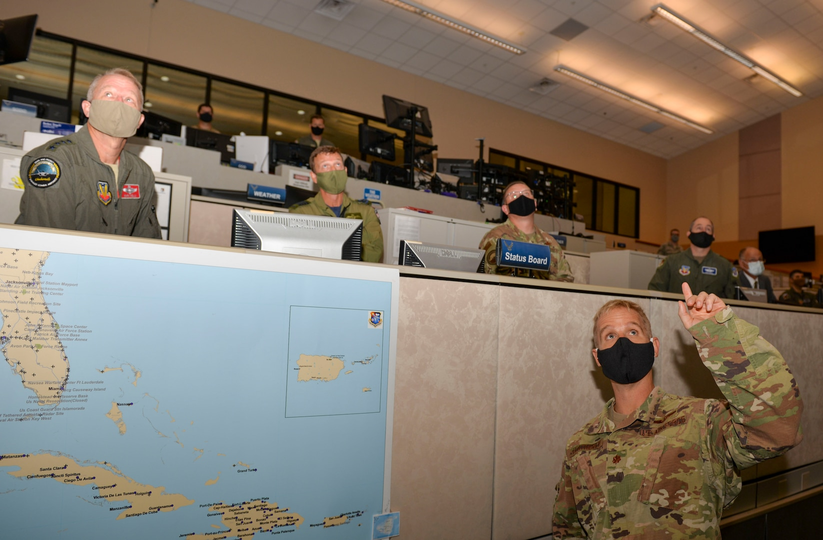U.S. Air Force Maj. John Heatherly, 601st Air Operations Center Combat Plans Division, briefs U.S. Air Force Gen. Mark Kelly, commander of Air Combat Command, and U.S. Air Force Chief Master Sgt. David Wade, the command chief of Air Combat Command, on how the AOC conducts missions throughout the continental United States during a visit to Tyndall Air Force Base, Florida, Sept. 29, 2020.