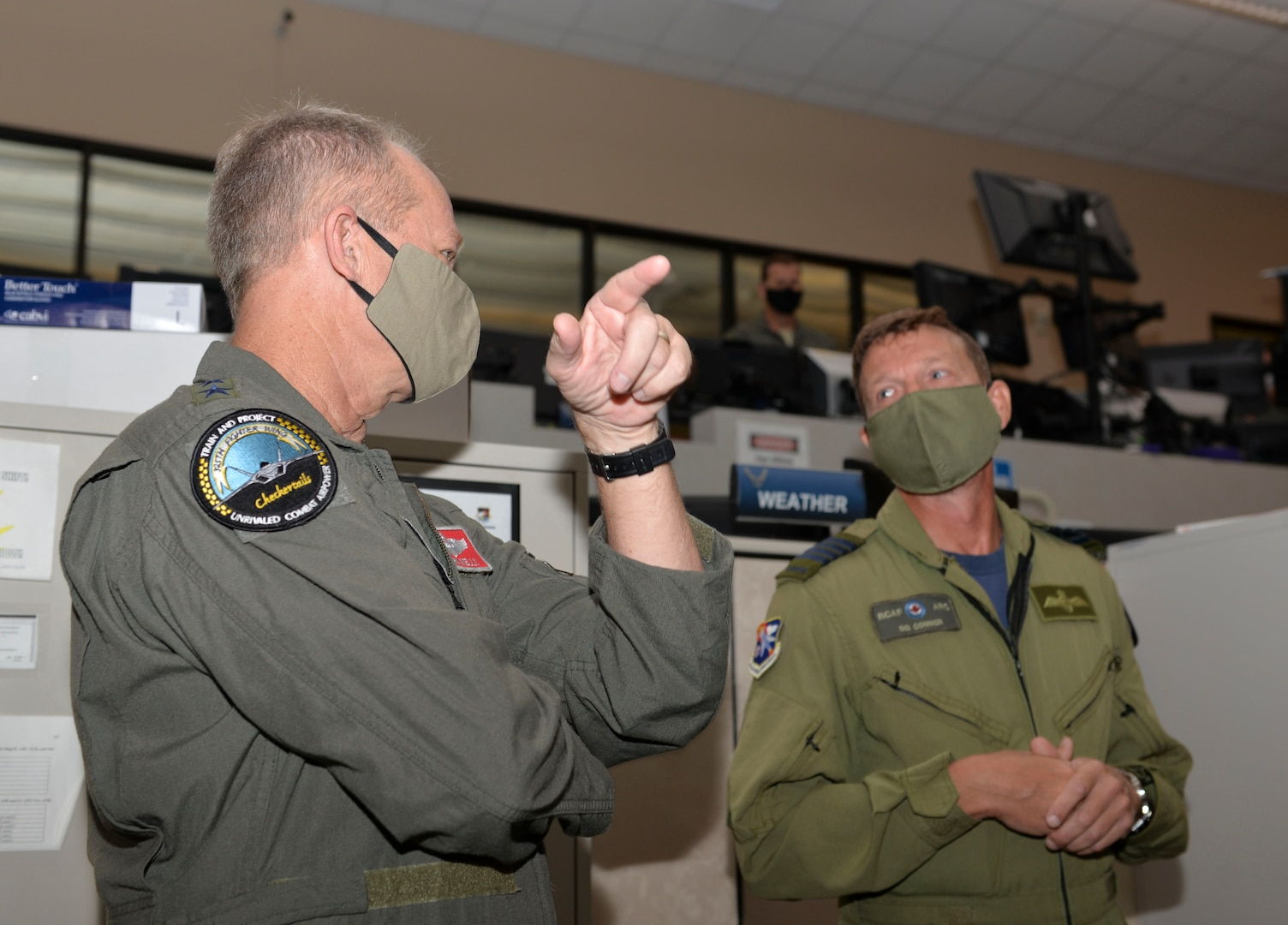 U.S. Air Force Gen. Mark Kelly, commander of Air Combat Command, talks with Royal Canadian Air Force Col. Sidney Connor, 601st Air Operations Center deputy commander, during a visit to Tyndall Air Force Base, Florida, Sept. 29, 2020.