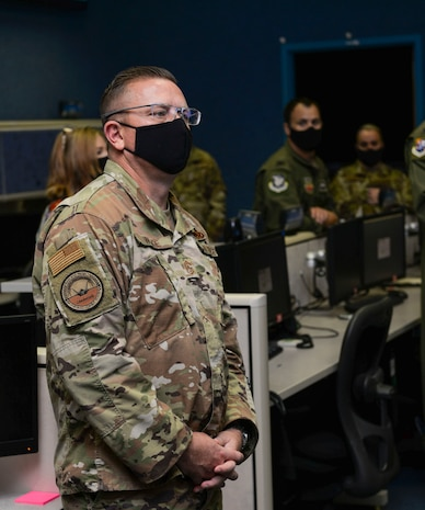 U.S. Air Force Chief Master Sgt. David Wade, the command chief of Air Combat Command, listens to a briefing on the 601st Air Operations Center's air mobility operations during a visit to Tyndall Air Force Base, Florida, Sept. 29, 2020.