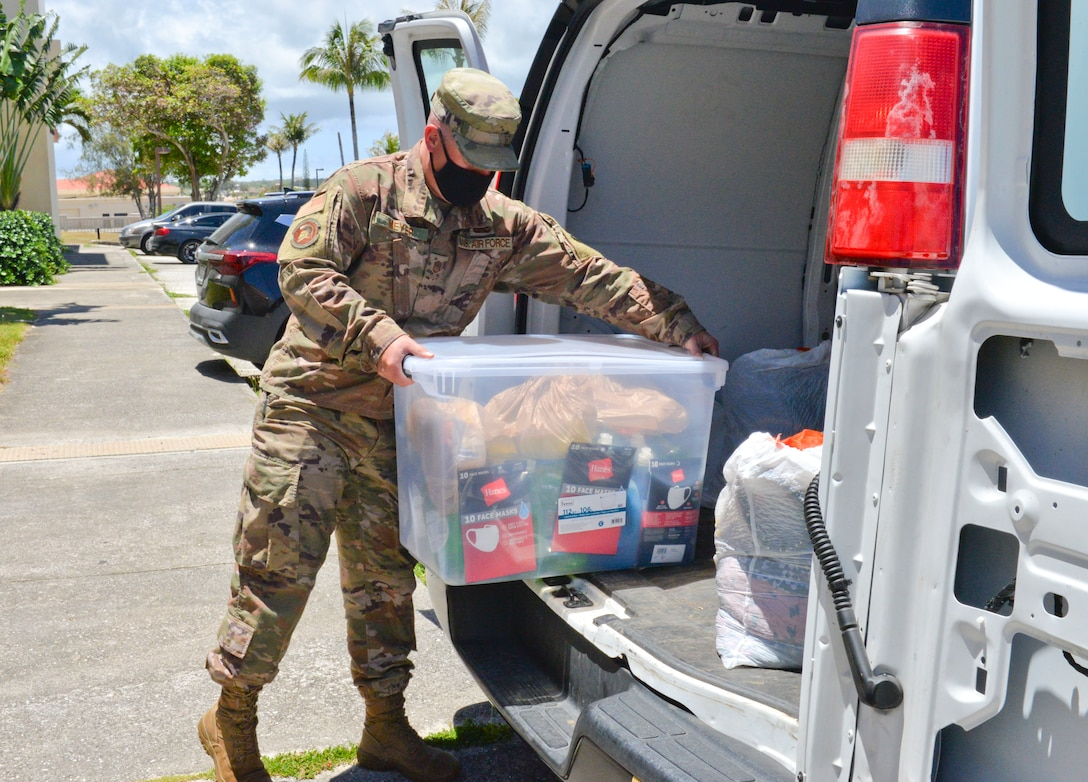 U.S. Air Force Master Sgt. Travis Meyer, 36th Operations Support Squadron radar, airfield, and weather systems superintendent, loads a bin of goods into a van at Andersen Air Force Base, Guam, March 31, 2021. U.S. Air Force Airmen from squadrons across the 36th Wing gathered nearly 3,000 pounds of essential items provided by fellow service members, civilians, and dependents to donate to the Alee Shelter, a local nonprofit organization and safe house for women and children affected by domestic violence and sexual abuse. (U.S. Air Force photo by Alana Chargualaf)