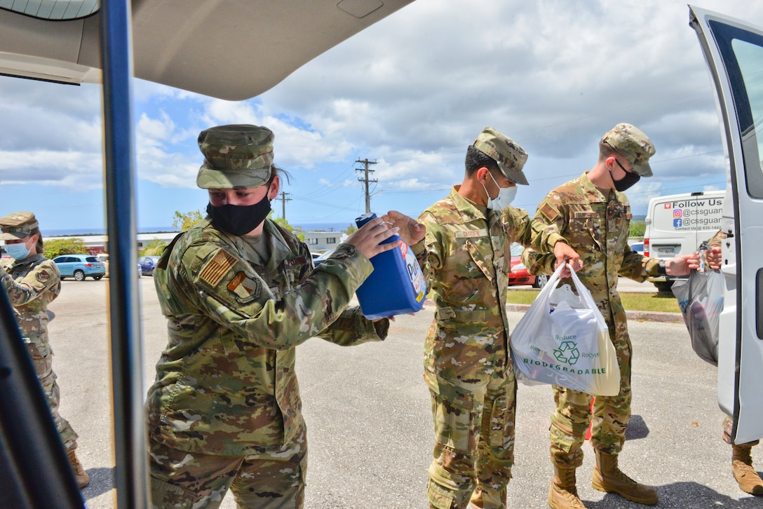 U.S. Air Force Airmen, assigned to the 36th Wing, load goods into a van during a donation delivery at Catholic Social Services in Barrigada, Guam, March 31, 2021. U.S. Air Force Airmen from squadrons across the 36th Wing gathered nearly 3,000 pounds of essential items provided by fellow service members, civilians, and dependents for the Alee Shelter, a local nonprofit organization and safe house for women and children affected by domestic violence and sexual abuse. (U.S. Air Force photo by Alana Chargualaf)