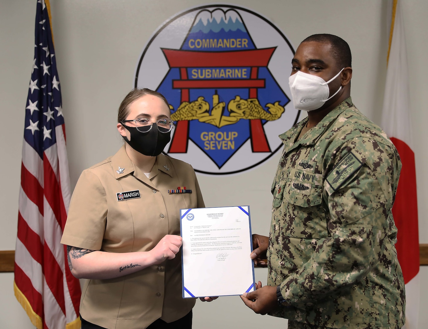 YOKSUKA, Japan (Mar. 10, 2021) Information Systems Technician 2nd Class Morgan Marsh, a native of Sparks, Nevada, receives her frocking letter during her pinning ceremony held at Commander, Submarine Group 7. (U.S. Navy photo by Mass Communication Specialist 2nd Class Adam K. Thomas)