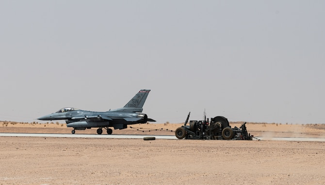 A 77th Expeditionary Fighter Squadron pilot tests an arrest cable March 31, 2021, at Prince Sultan Air Base, Kingdom of Saudi Arabia.