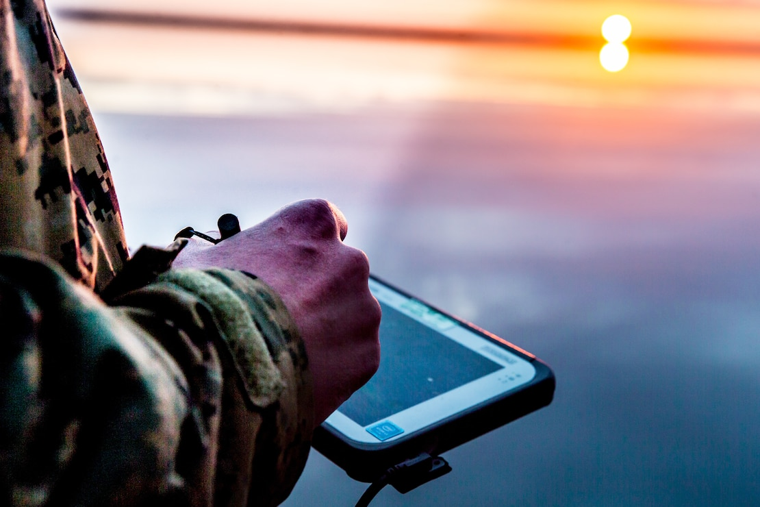 U.S. Marine Corps Sgt. Jeramiah Meade, a section chief with 2nd Radio Battalion, 2d Marine Division, uses a electronic warfare system during a joint-service training exercise on Marine Corps Air Station Cherry Point, N.C., March 26, 2021. The purpose of the week-long training was to increase interoperability with the U.S. Coast Guard and provide 2d Marine Division reconnaissance battalions with the opportunity to become familiarized with quick reaction and counter electronic warfare concepts. (U.S. Marine Corps photo by Cpl. Elijah Abernathy)