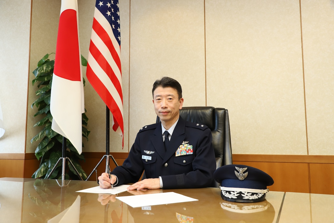 Japan Air Staff Office general signs a memo of understanding.