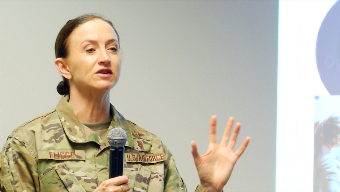 Image of an Airman giving a presentation.