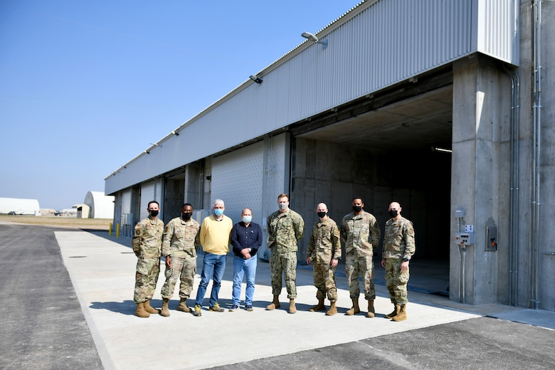 U.S. Air Force, U.S. Navy and contracting personnel, along with 31st Fighter Wing leadership, stand before three new earth-covered munitions storage modules on Area F at Aviano Air Base, Italy, March 31, 2021. Planning for the modules began in 2014, with construction starting March 2020 and finishing one year later. (U.S. Air Force photo by Staff Sgt. K. Tucker Owen)
