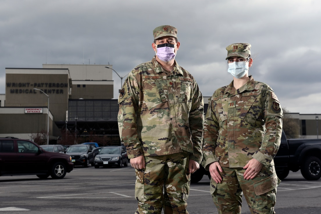 Air Force Maj. Eric Mozeleski, an emergency medicine physician with the 88th Medical Group, and Capt. Carly Kerr, a critical care nurse with 88 MDG, talk outside the Wright Patterson Air Force Base, Ohio, Medical Center on March 31, 2021. Both Mozeleski and Kerr became first responders on March 23 when they attended to rollover auto accident victims as they commuted to work at Wright-Patt. Mozeleski and Kerr stabilized two victims and waited for emergency services to arrive. (U.S. Air Force photo by Ty Greenlees)