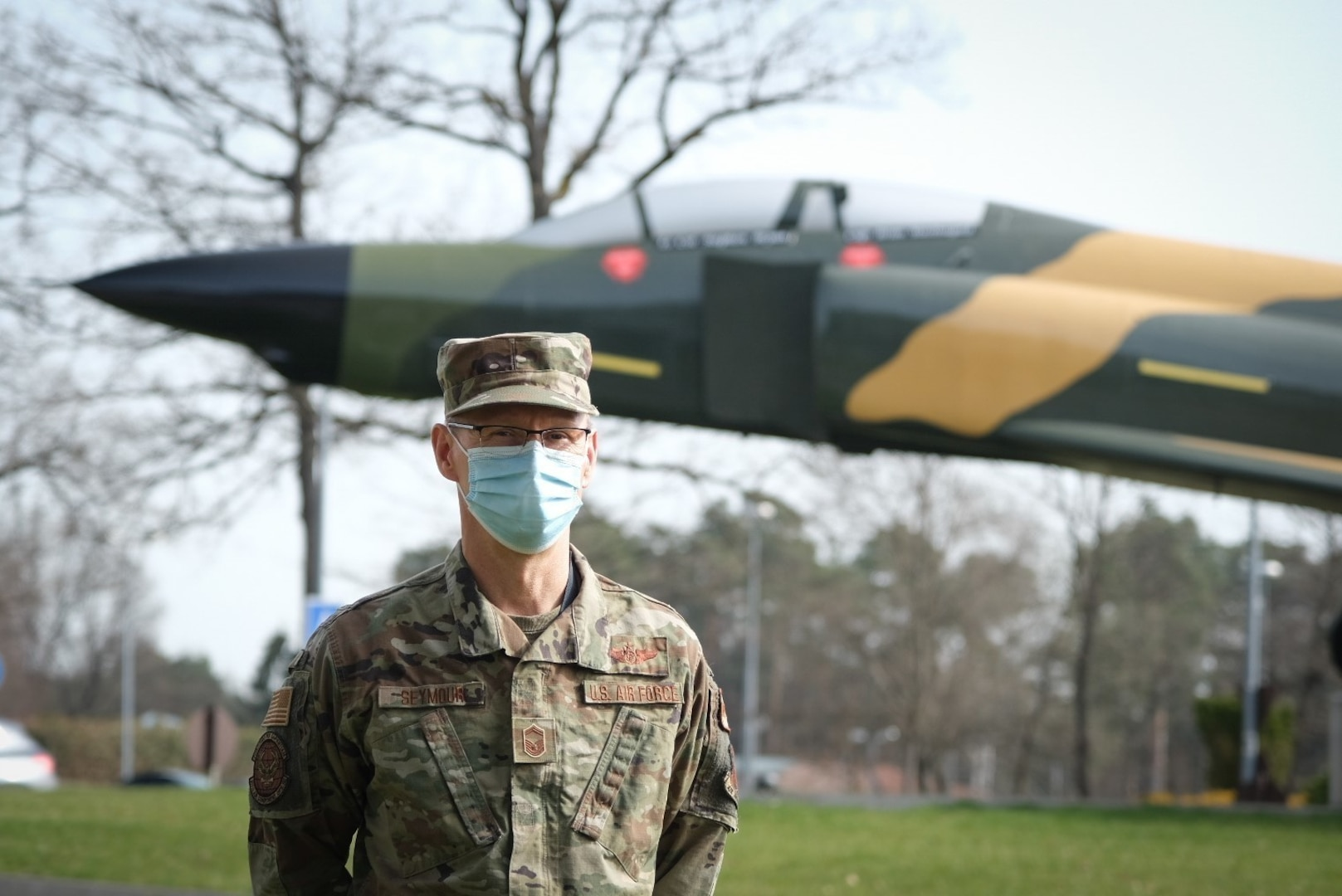 U.S. Air Force Senior Master Sgt. Brad Seymour, technician lead, chief of combat operations for the 603d Air Operations Center, stands for a portrait near a static display F-4 Phantom at Ramstein Air Base, Germany, April 1, 2021. Seymour is a member of the Michigan Air National Guard's 110th Wing, 217th Air Operations Group.