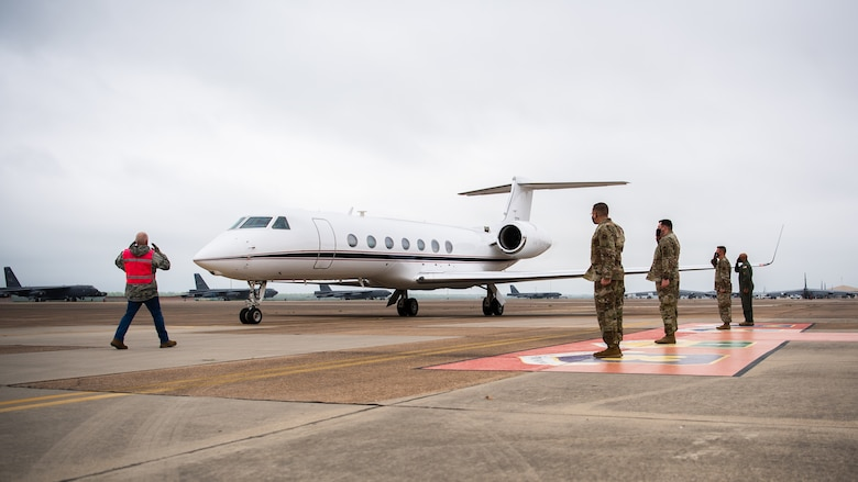 Leaders from the 2nd Bomb Wing and Air Force Global Strike Command salute during the arrival of Adm. Charles Richard, U.S. Strategic Command commander, at Barksdale Air Force Base, Louisiana, March 30, 2021. Richard visited Barksdale to present the 96th Bomb Squadron with the 2020 Omaha Trophy, a prestigious award given to premier units of USSTRATCOM. (U.S. Air Force photo by Airman 1st Class Jacob B. Wrightsman)
