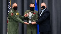 (Left to right) Adm. Charles Richard, U.S. Strategic Command commander, Lt. Col. Christopher Duff, 96th Bomb Squadron commander, and Mr. Tim Burke, Strategic Command Consultation Committee chairman, hold the Omaha Trophy during the presentation of the Omaha Trophy to the 96th BS at Barksdale Air Force Base, Louisiana, March 30, 2021. The 96th BS is the first bomb squadron to be presented the prestigious award. (U.S. Air Force photo by Airman 1st Class Jacob B. Wrightsman)