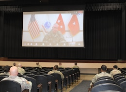 general officer speaks on screen