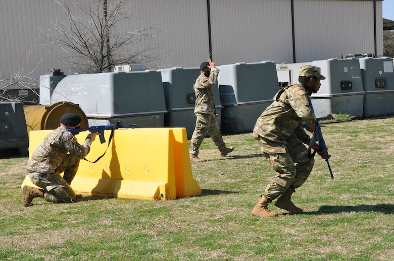 301st Fighter Wing Security Forces Squadron fire team members, (Left) Staff Sgt. Clay Wallace and (right) Staff Sgt. Ryan Gomas perform fire team movements during a field training exercise at U.S. Naval Air Station Joint Reserve Base Fort Worth, Texas on March 6, 2021. With SFS's mission being to protect, defend and fight, Airmen must learn how to maneuver to, or away from a threat and communicate those movements with their team so that it can be done effectively and in a coordinated fashion. (U.S. Air Force photo by Senior Airman William Downs)