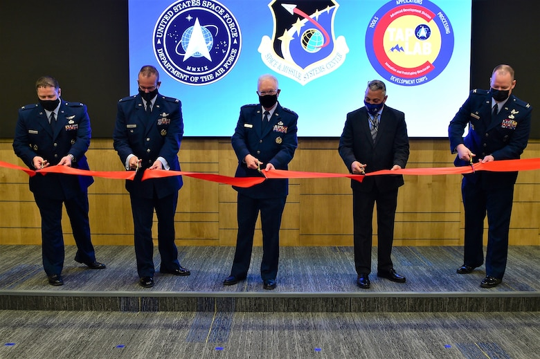 SMC hosted a grand re-opening ribbon-cutting ceremony to unveil the new renovated state-of-the-art TAP Lab on Mar. 31, 2021 in Boulder, Colo. Pictured in the ribbon-cutting are (l-r) Col Dennis Birchenough, Senior Material Leader, Advanced Development Division, Col. Timothy A. Sejba, program executive officer, Space Development, Lt. Gen. John F. Thompson, SMC commander and program executive officer for Space, Steven Polliard,  Director, TAP Lab and Col. Joseph J. Roth, Director, SMC's Innovation and Prototyping Directorate.  (U.S. Space Force photo by Senior Airman Danielle McBride)
