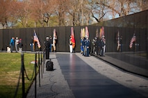 """In recognition of National Vietnam War Veterans Day on Monday, March 29, 2021, Trumpet Player Gunnery Sgt. Benjamin Albright sounded """"Taps"""" at the National Vietnam Veterans Memorial Wall in Washington, D.C. During the ceremony, Secretary of Defense Lloyd J. Austin III and Secretary of Veterans Affairs Denis R. McDonough laid a wreath in honor Vietnam War veterans."""