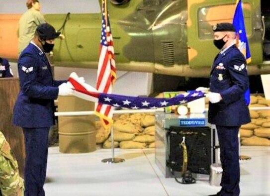 Men folding flag