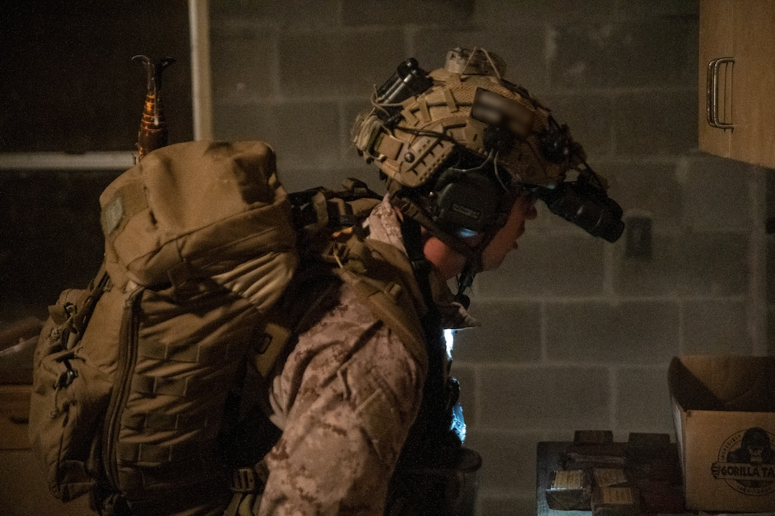 Marine Raiders with Golf Company, 2nd Marine Raider Battalion, execute a night raid in support of the Logistics Support Team, Golf Company, 2nd Marine Raider Support Battalion, during Training Exercise II at Marine Corps Base Camp Lejeune, N.C., Dec.11, 2020. This training allows the LST to be evaluated prior to attaching to a Marine Special Operations Company that, in turn, will be capable of supporting full-spectrum special operations. (U.S. Marine Corps photo by Cpl. Brennan Priest)