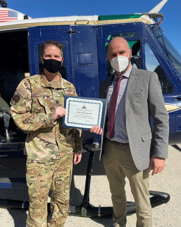 Lt. Col. James Rankin, 1st Helicopter Squadron commander, presents an induction certificate to Dr. John Barnhardt, president and CEO, Bishop McNamara High School, in preparation for the virtual Honorary Commanders Program ceremony on Joint Base Andrews, Md., March 25, 2021. The JBA Honorary Commanders Program gives each inducted local community leader an opportunity to build a relationship with the base and its people. (U.S. Air Force courtesy photo)