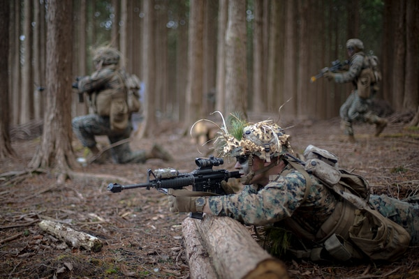 A U.S. Marine engages targets during a live-fire range on Camp Hansen, Okinawa, Japan, March 5.