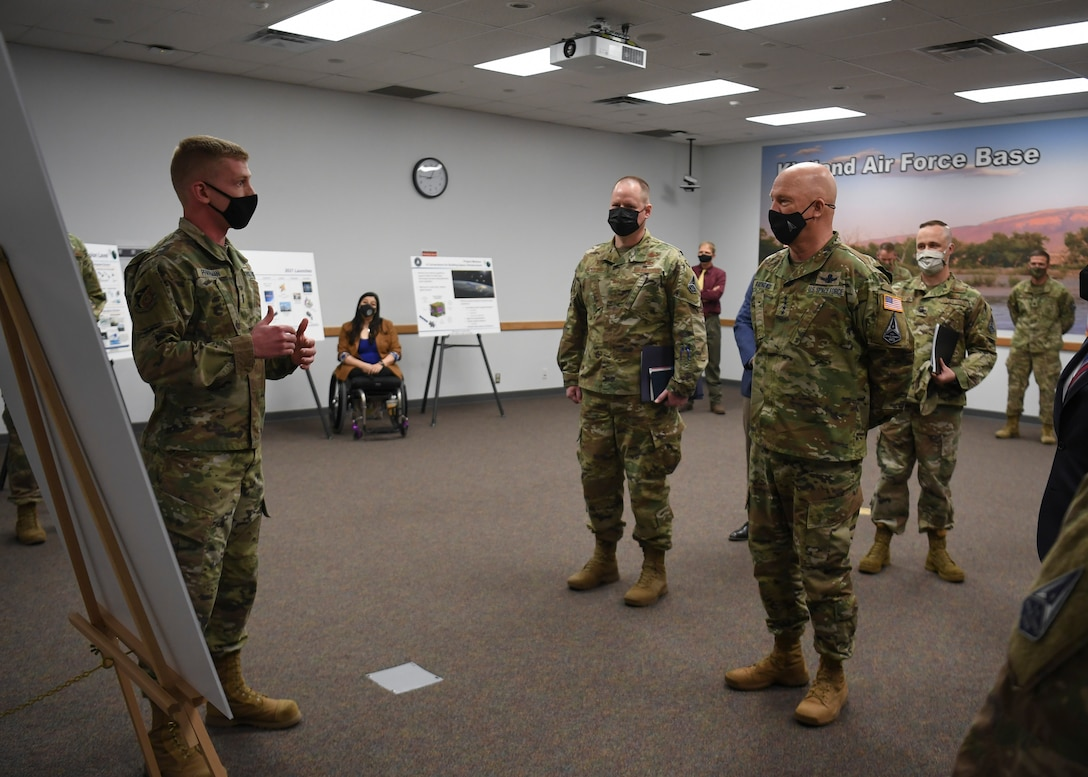 Military member speaks to other military members in room