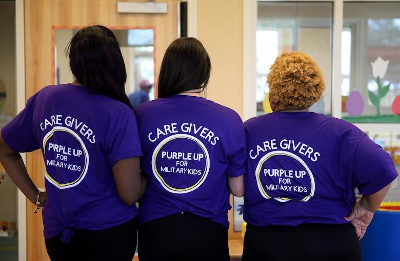 Caregivers wear Purple Up t-shirts.