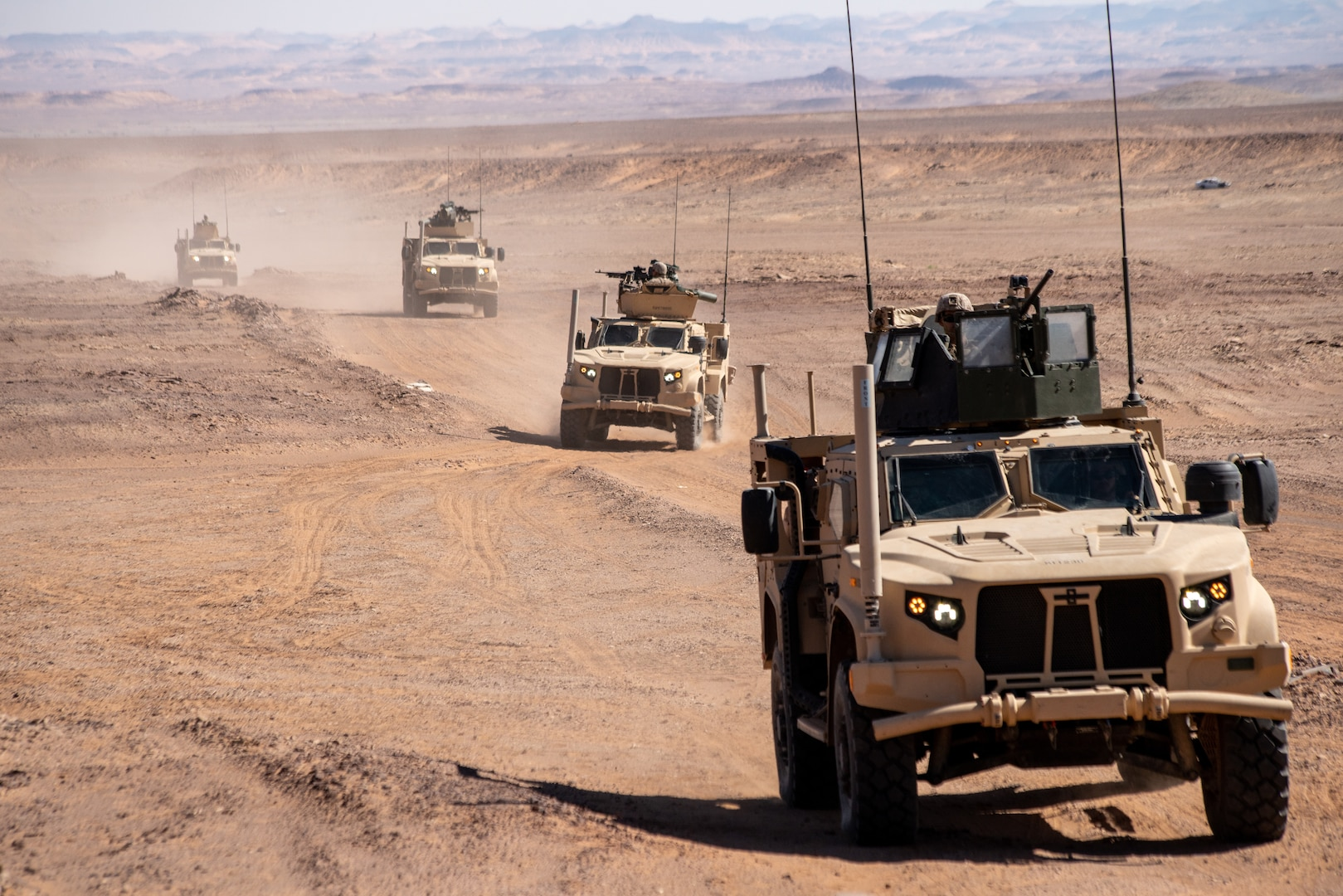 U.S. Marine Corps joint light tactical vehicles maneuver to a vehicle staging area during a theater amphibious combat rehearsal in Tabuk, Kingdom of Saudi Arabia, March 7.