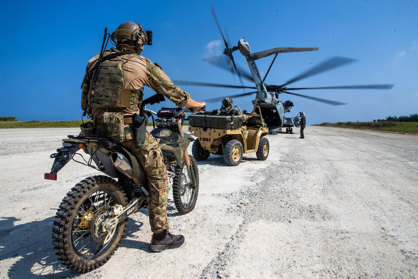 A U.S. Army Soldier prepares to load a CH-53E Super Stallion with 1st Marine Aircraft Wing during Castaway 21.1 on Ie Shima, Okinawa, Japan, March 17.
