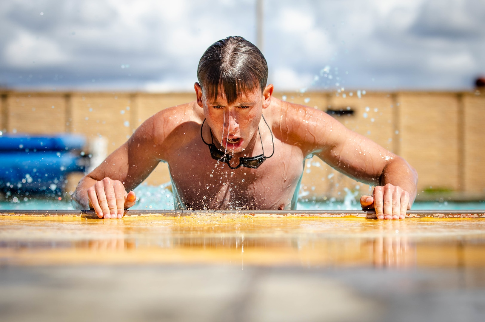 A U.S. Marine participates in a poolside workout at Marine Corps Base Camp Pendleton, Calif., March 11.