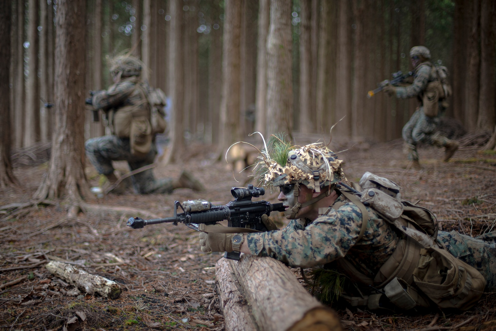 U.S. Marine advance during a force on force exercise at Combined Arms Training Center Camp Fuji, Japan, March 4.