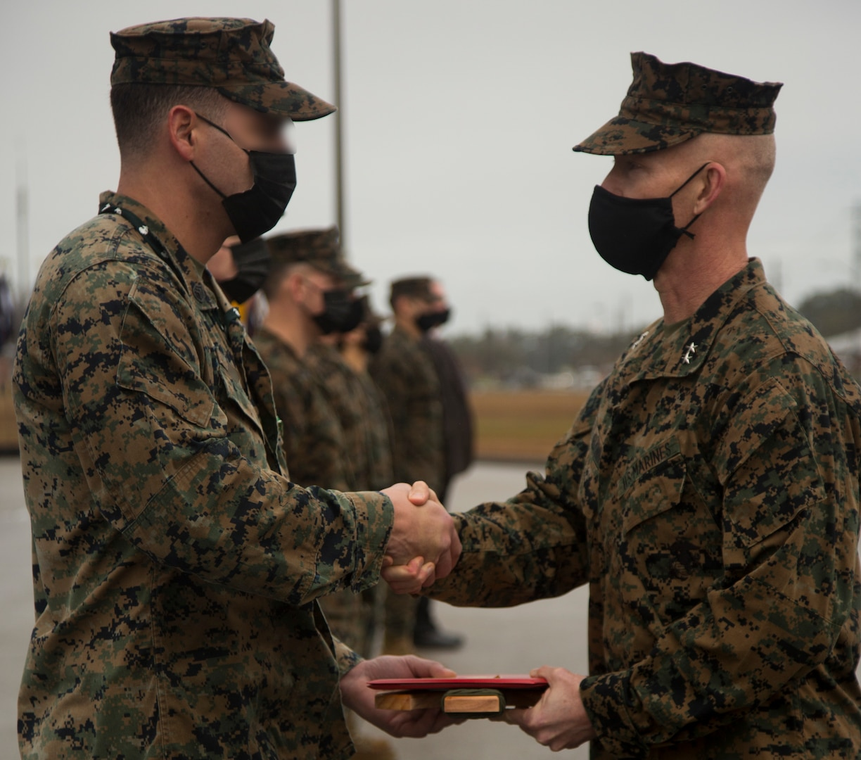 Personnel with Marine Forces Special Operations Command are awarded for their accomplishments during a ceremony at Camp Lejeune, N.C., Feb. 22, 2021. On Feb. 24, 2006, the Marine Corps combined several of its specialized and uniquely trained units, gave them a name and a commander and directed them to become pioneers in a new chapter of Marine Corps history. (U.S. Marine Corps photo by Sgt Jesula Jeanlouis)
