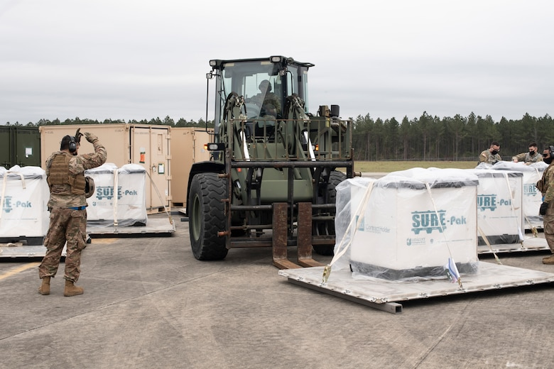 Aerial porters from the 321st Contingency Response Squadron process pallets of simulated relief supplies March 26, 2021, during Exercise Turbo Distribution 21-2 at Camp Shelby, Mississippi. Turbo Distribution is a joint task force port opening aerial port of debarkation field training exercise that was held March 24-31. Participating units included the 621st Contingency Response Group stationed at Joint Base McGuire-Dix-Lakehurst, New Jersey, and the U.S. Army 688th Rapid Port Opening Element stationed at Joint Base Langley-Eustis, Virginia. (U.S. Air Force photo by Tech. Sgt. Luther Mitchell)