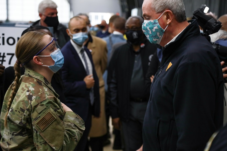 New Jersey governor Phil Murphy converses with U.S. Air Force Airman 1st Class Hannah Zegel, a Millville, New Jersey, native and aerospace medical service specialist assigned to the 59th Medical Operations Squadron.