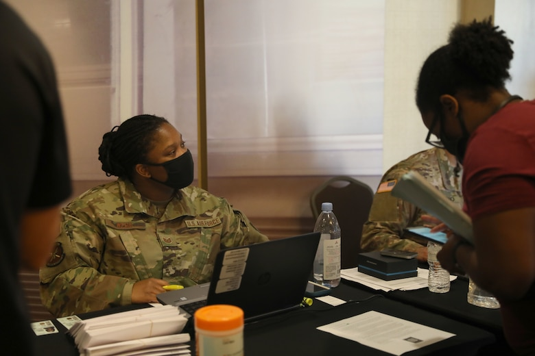 U.S. Air Force Tech Sgt. Tanika Webb, a Sanders Field, Georgia, native and personnel specialist assigned to the 7th Force Support Squadron, checks in Airmen that will support the state-run, federally-supported COVID-19 Community Vaccination Center