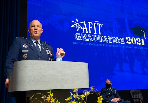 United States Space Force Gen. John W. Raymond, Chief of Space Operations, gives the graduation address at the Air Force Institute of Technology graduation ceremony on Wright-Patterson Air Force Base, Ohio. March 25, 2021. The graduating class of more than 200 students included 33 Guardians earning their advanced degrees. (U.S. Air Force photo by R.J. Oriez)